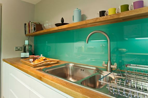 kitchen-with-green-back-painted-glass-backsplash-from-dhv-architects-via-houzz